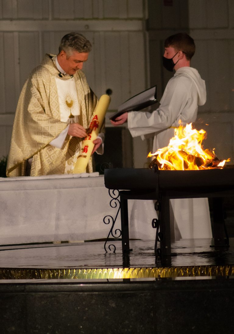 Fr Richard Gibbons with the Paschal Candle outside Knock Basilica at the Holy Saturday Vigil. Photo Sinead Mallee