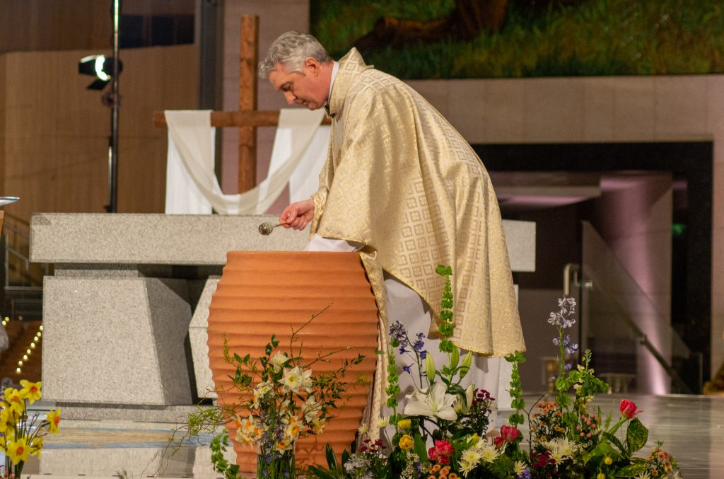 Fr Richard Gibbons, Rector Knock Shrine, blesses the Easter Holy Water. Photo Sinead Mallee 1