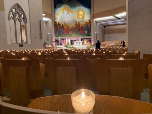 A candle burns in each of the 3200 seats at Knock Basilica during the Holy Saturday Vigil Mass at Knock Shrine celebrated by Fr Richard Gibbons and broa